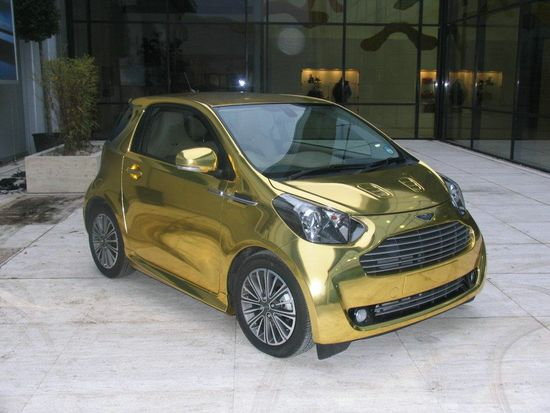 aston martin cygnet in gold luxuryes. Black Bedroom Furniture Sets. Home Design Ideas