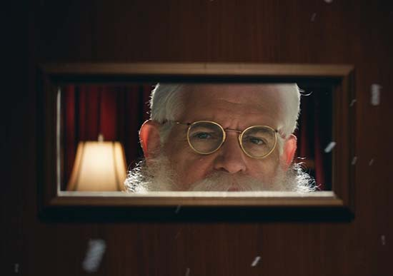 Santa Gets a Naughty Visitor in Coach's Holiday Film